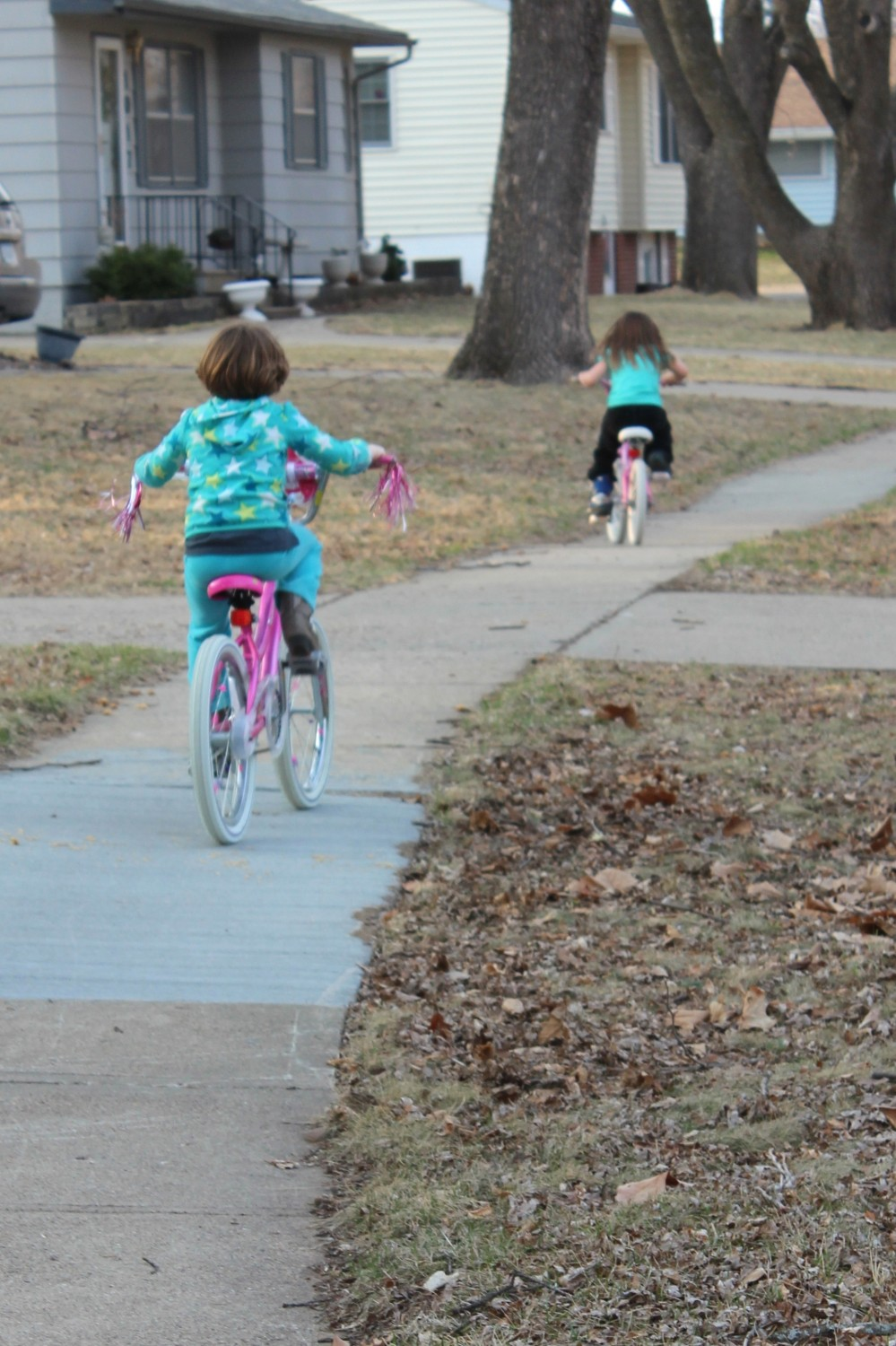 My little girls riding their bikes in the neighborhood last year: June was 6 and Rory was 4.