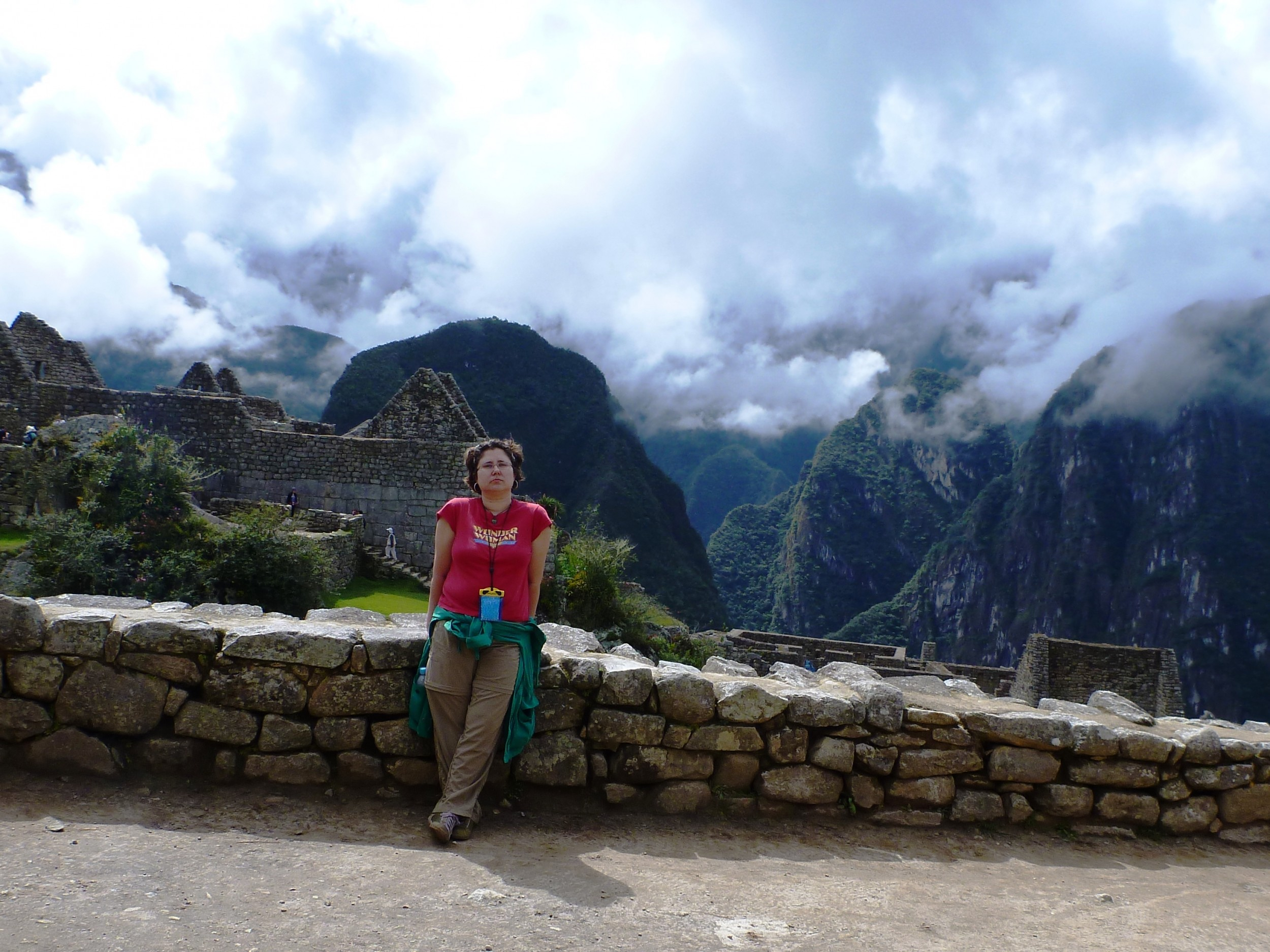 At Machu Picchu, so exhausted I had to lean on the wall when we stopped.