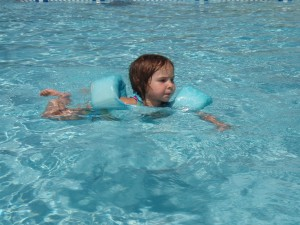 Rory, age 2, paddling across the deep end of the pool.