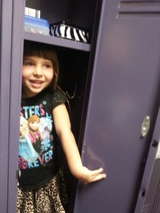 Rory fits into June's new locker...