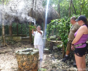 Mayan purification ceremony before entering the sacred cenote.